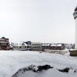 Fotografie vuurtoren in de sneeuw